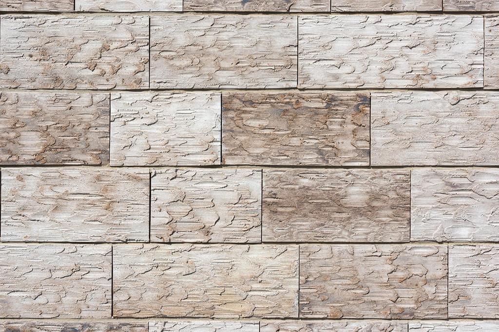 close up van lichte grove stenen muur