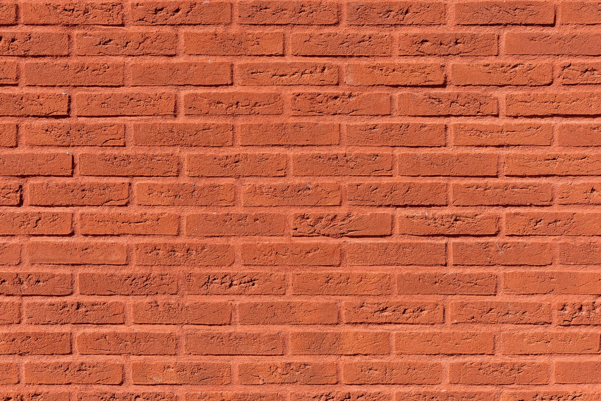 Detail van rode muur met rode voeg