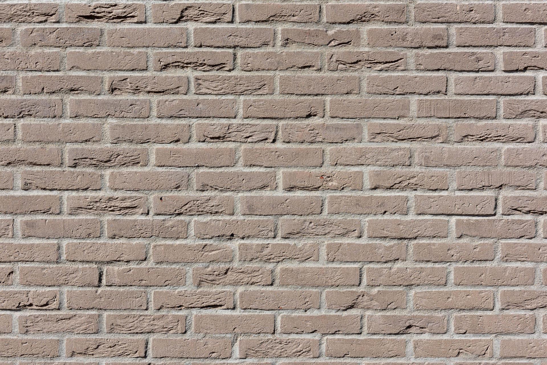 Detail van een muur met lichtbruine steen