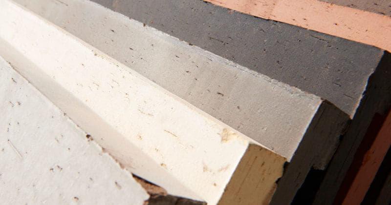 Waaier van zeven kleuren sidings van Pantheon Nordic die over elkaar liggen, van dichtbij