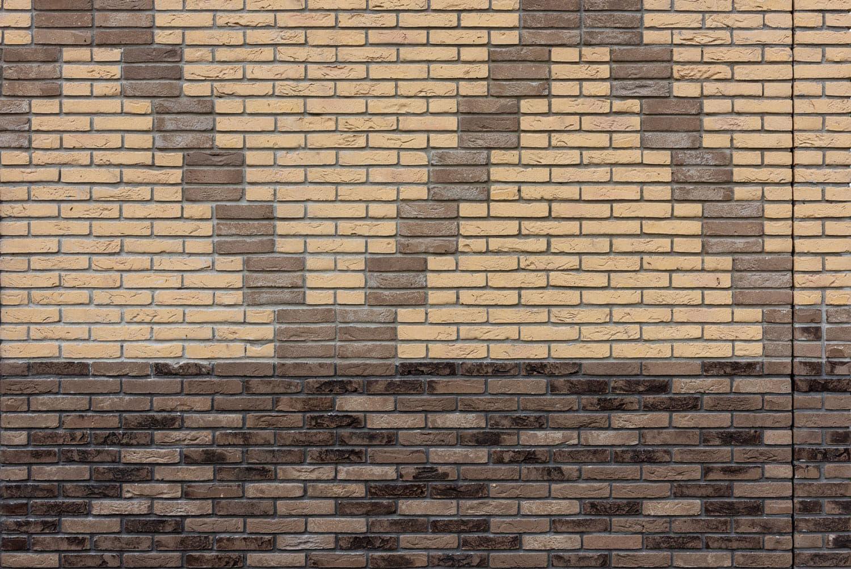 Muur van bakstenen met tekening erin