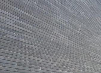 Grijze muur met strips