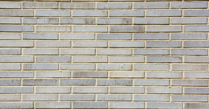 Strijp R detail van muur met lichtgrijze baksteen