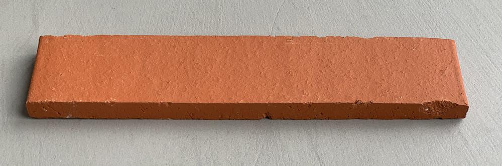 Oranje steenstrip